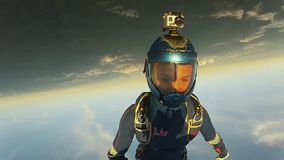 Two professional skydivers jump from airplane fall in sky together. Uniform. stock footage