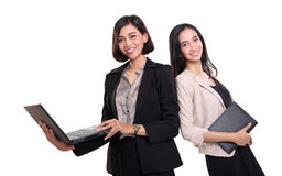 Two professional women posing with notebooks Stock Photos