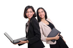 Two professional women smiling at each other Stock Photo