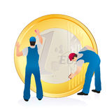 Two professionals cleaning the big Euro coin Stock Images