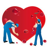 Two professionals wiping the bleeding heart Royalty Free Stock Photo