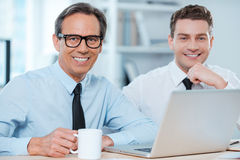 Two professionals at work. Royalty Free Stock Image
