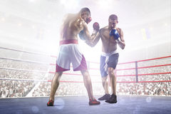 Two professionl boxers are fighting on arena Stock Images