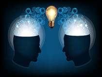 Two profile faces with light bulb Royalty Free Stock Images