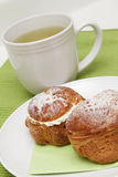 Two profiteroles and tea Stock Image