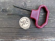 Two prong cork puller and 2015 wine cork Stock Photography