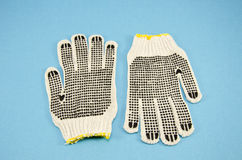 Two protective glove on azure background Stock Photography