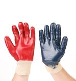 Two protective gloves on hands. Stock Image