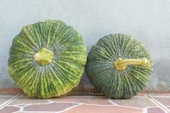 Two Pumpkin on floor Stock Images