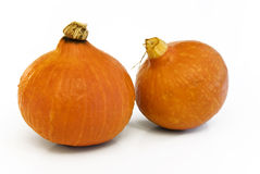 Two Pumpkins. Two orange Pumpkins lying on white background royalty free stock images
