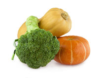 Two pumpkins and broccoli Royalty Free Stock Photos