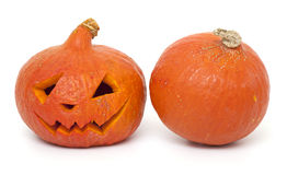 Two pumpkins, full and angry one Stock Image