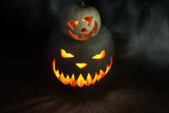 Two pumpkins on Halloween. Together spooky and funny with smoke Royalty Free Stock Photography