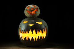 Two pumpkins on Halloween together spooky under funny Royalty Free Stock Images