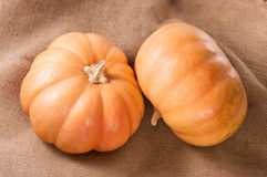 Two Pumpkins On Sackcloth Royalty Free Stock Photography