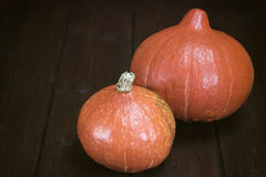Two pumpkins on the wooden table Royalty Free Stock Photo