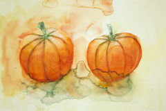 Two pumpkins with yellow and orange background. Royalty Free Stock Image