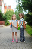 Two pupils, boy and girl, on the way to school. Stock Image