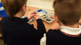 Two pupils at the lesson of robotics at school. NOVOSIBIRSK, RUSSIA - JANUARY 20, 2016: Two boy pupils working with Lego meccano set during the robotics class at stock video