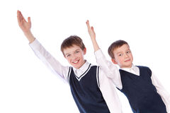 Two pupils raise their hands up Royalty Free Stock Photos