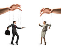 Two puppet businessman. Image of a two puppet businessman standing on against each other, concept of business control Stock Photo