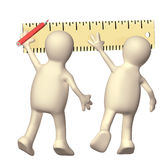 Two puppets with ruler Stock Photos