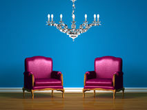 Two purple chairs in blue minimalist interior Stock Photo