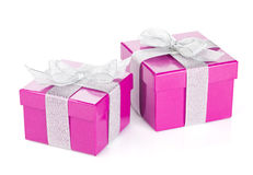 Two purple gift boxes with silver ribbon and bow Stock Photo