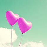 Two Purple Heart-shaped balloons Royalty Free Stock Image