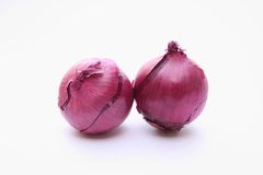 Two purple onions. On a white background Stock Image