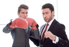 Two purposeful businessmen are in the office. The concept of business competition royalty free stock photo