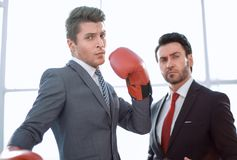Two purposeful businessmen are in the office. The concept of business competition royalty free stock image