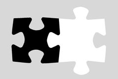Two puzzle pieces. (black and white) on gray Stock Images