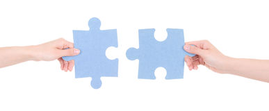 Two puzzle pieces in woman hands isolated on white Stock Photos