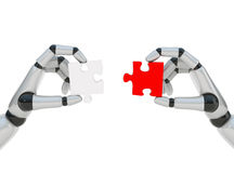 Two puzzles in two robohands Stock Images