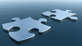 Two puzzles on a water surface. 3D image Stock Photography