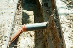 Two pvc sewer pipe connected underground in the trench on the street. Two pvc sewer pipe connected underground in the trench on the street stock photography
