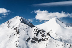 Two Pyramid Shaped Snowcapped Mountain Peaks Stock Images