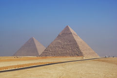 Two Pyramids of Giza at foggy morning Royalty Free Stock Image