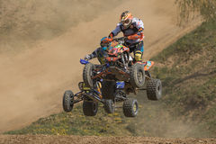 Two quad riders are jumping over the horizon Stock Photography