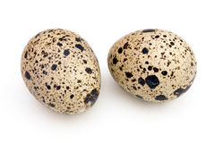 Two quail eggs on white Stock Photos