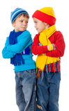 Two quarreling kids in winter clothes Stock Images