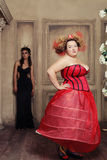 Two queens in carnaval dress. Black and red. Stock Photos