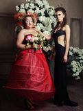 Two queens in carnaval dress. Black and red. Royalty Free Stock Photography