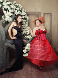 Two queens in carnaval dress. Black and red. Stock Images