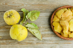 Two quince fruits and quince slices Royalty Free Stock Photography