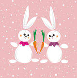 Two rabbits with carrot Royalty Free Stock Images