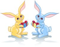 Two rabbits and gift. Royalty Free Stock Photos