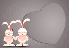 Two rabbits in love with heart Stock Photo
