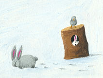 Two rabbits and one bird in the winter Royalty Free Stock Image